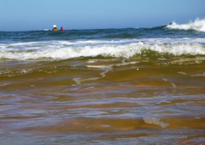 kayakers in the surf