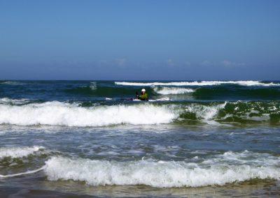 kayaker in the surf matanzas inlet