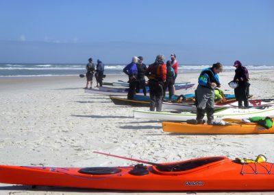 kayak group on the beach at matanzas inlet
